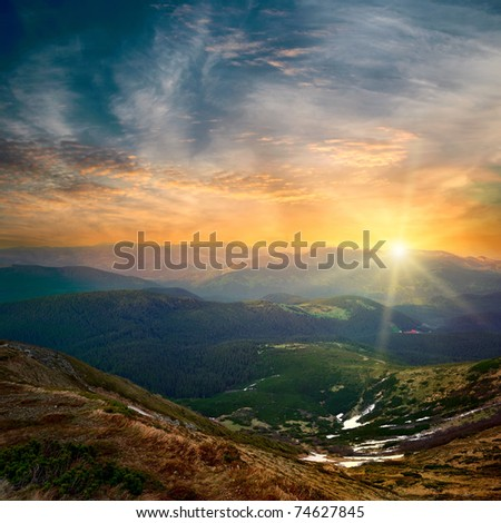 majestic mountain sunset and colored sky with clouds