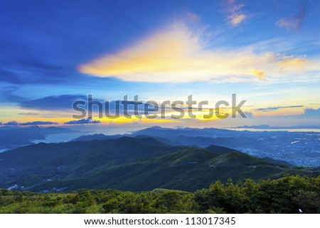 Majestic mountain sunset and sky with colorful clouds