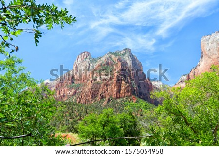 Majestic mountain view in Zio National Park. Framed with lush green trees on a rich blue sky. Zdjęcia stock ©