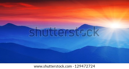 Majestic mountains landscape under morning sky with clouds. Carpathian, Ukraine. #129472724