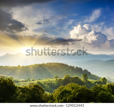 Majestic mountains landscape under morning sky with clouds. Overcast sky before storm. Carpathian, Ukraine, Europe. #129012443