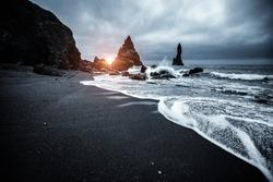 Majestic place of the stormy Atlantic ocean. Basalt rocks