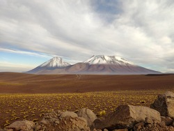 Majestic scenery of Licancabur volcano with top covered with snow located in Chile