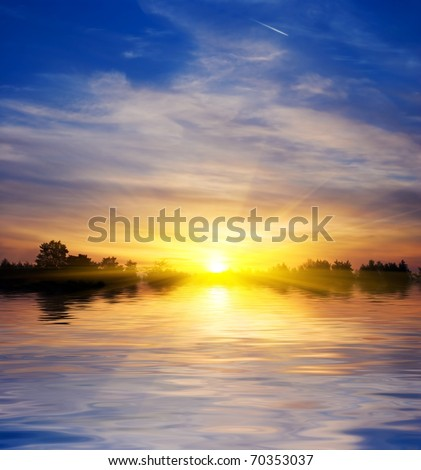 majestic sun rising from a lake panorama