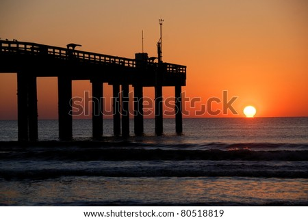 Majestic sunrise just over the horizon at St. Augustine Beach Florida - stock photo