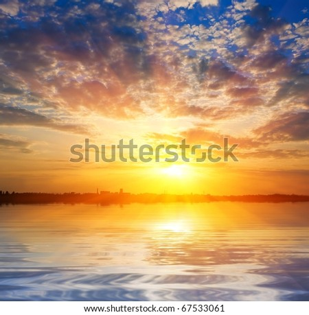 majestic sunrise over a water #67533061
