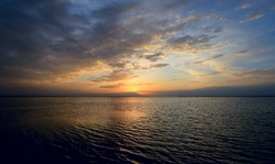 majestic sunset clouds in sky over sea water