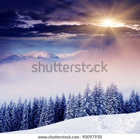 Majestic sunset in the foggy mountains landscape. Dramatic sky.