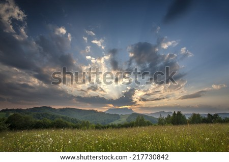 Majestic sunset in the mountains landscape #217730842