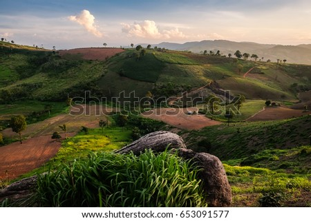 Majestic sunset in the mountains landscape. Dramatic sky. #653091577