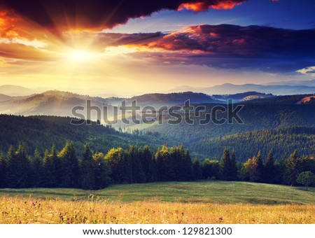 Majestic sunset in the mountains landscape. Dramatic sky. Carpathian, Ukraine, Europe. #129821300