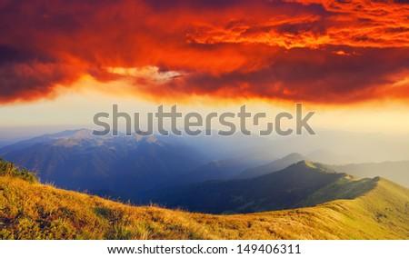 Majestic sunset in the mountains landscape. Overcast sky before storm. Carpathian, Ukraine, Europe. #149406311