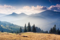 Majestic sunset in the mountains landscape with sunny beams. Dramatic scene. Carpathian, Ukraine, Europe. Beauty world.