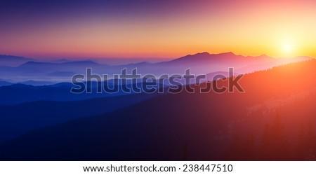 Majestic sunset in the mountains landscape with sunny beams. Dramatic scene. Carpathian, Ukraine, Europe. Beauty world. Retro style, vintage filter. Instagram toning effect. #238447510