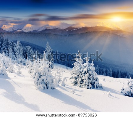 Majestic sunset in the winter mountains landscape. Dramatic sky. #89753023