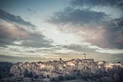 Majestic sunset over ancient Italian town Pitigliano, Tuscany, Italy. Lomography style, retro photo