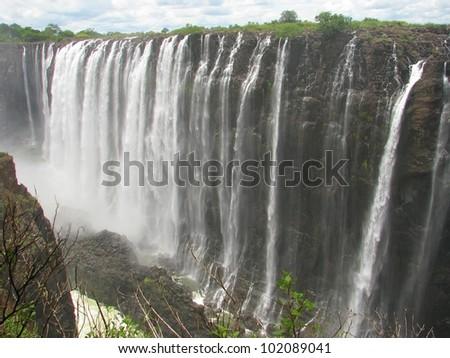 Majestic Victoria Falls on Zambezi River, border of Zambia and Zimbabwe