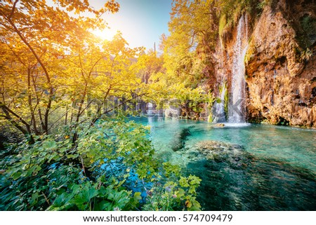 Majestic view on turquoise water and sunny beams. Unusual and gorgeous scene. Location famous resort Plitvice Lakes National Park, Croatia, Europe. Beauty world. Retro filter. Instagram toning effect.