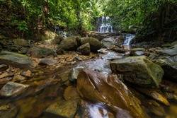 Majestic waterfall in the dense rainforest of Kubah National Park, West Sarawak, Borneo, Malaysia.