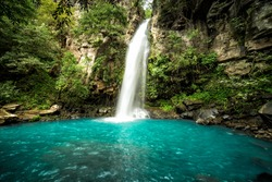 Majestic waterfall in the rainforest jungle of Costa Rica.  La Cangreja waterfall in Rincon de La Vieja National Park, Guanacaste