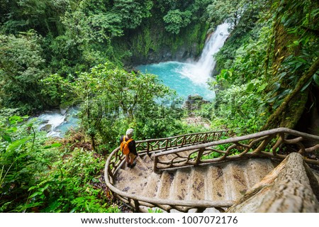 Majestic waterfall in the rainforest jungle of Costa Rica. Tropical hike. #1007072176