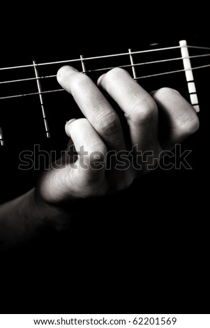 Major chord (C) on classical guitar; toned monochrome image;
