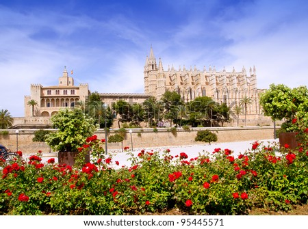 Majorca Cathedral and Almudaina from red flowers garden of  Palma de Mallorca