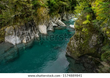 Makaroa Blue Pool located in Mount Aspiring National park in South Island, New Zealand.Crystal clear mountain river.