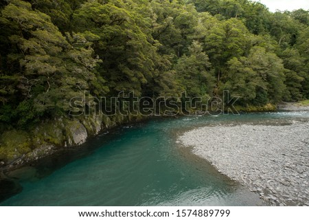 Makaroa River located in Mount Aspiring National park in South Island, New Zealand.Crystal clear mountain river.