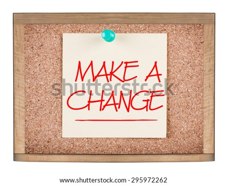 MAKE A CHANGE motivational quote written on a sticky note on corkboard. Isolated on a white background.