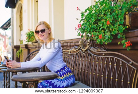 Make appointment. Woman smiling face with smartphone create appointment in social network and wait friends in cafe. Girl wait meeting with friends. Arrange appointment in social network.