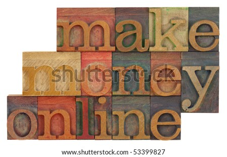 make money online phrase in vintage wood letterpress type blocks, stained by color inks, isolated on white