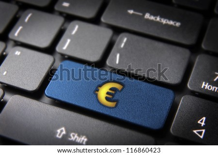 Make money with internet concept: blue key with yellow euro sign on laptop keyboard. Included clipping path, so you can easily edit it.