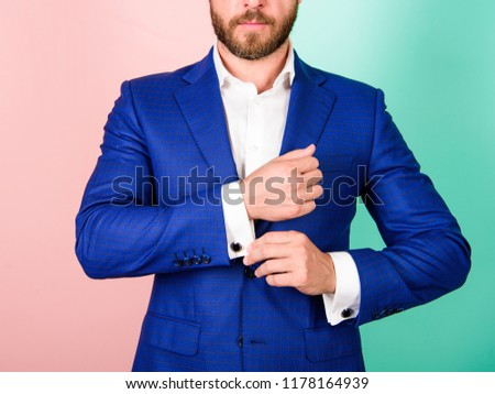 Make sure outfit and appearance look perfect. Details make outfit elegant. Male fashion. Perfect to last detail. Man well groomed businessman with beard strict face check button on shirt sleeve. #1178164939
