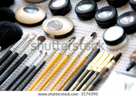 Make-up and brushes a table