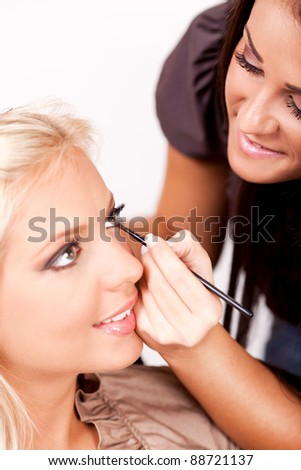 stock photo : Make-up artist applying makeup on beautiful woman