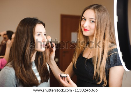 Make up artist doing professional make up of young woman. Beauty shcool. #1130246366
