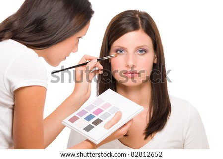 Make-up artist woman fashion model apply eyeshadow from color palette