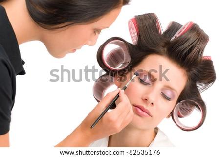 Make-up artist woman fashion model apply eyeshadow with brush