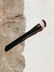 Make up brush, foundation stippling brush on concrete marble background