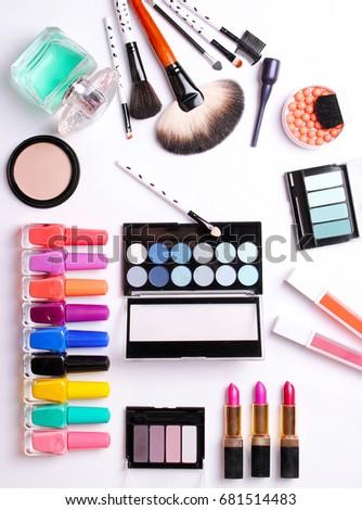 make-up brush, perfume, eye shadow, blush on the white background