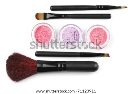 Make-up brushes and powder eye shadows in jars isolated on white background.