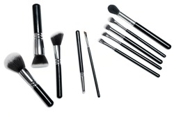 Make-up brushes isolated over white background. Professional makeup paintbrush. Natural and synthetic bristles, black handles and elegant looking make up artist tools.