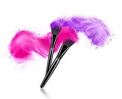 Make up brushes with powder splashes isolated on white background