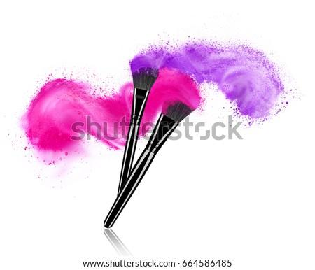 Make up brushes with powder splashes isolated on white background #664586485