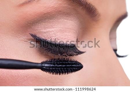 Make-up, close up of long eyelashes and brush mascara, Applying Mascara