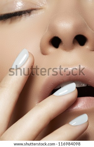 Make-up & cosmetics, manicure. Close-up portrait of beautiful woman model face with clean skin on white background. Natural skincare beauty, clean soft skin, manicure