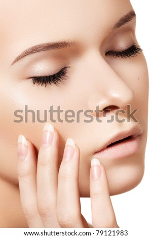 Make-up & cosmetics, manicure. Closeup portrait of beautiful woman model face with clean skin on white backgroun. Natural skincare beauty, clean soft skin, manicure