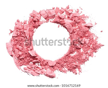 Make up crushed and broken pink eyeshadow, blush or powder on white background. Texture of crushed pink powder in the form of a round frame on white