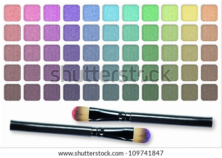 Make up palette of colorful eyeshadow with make up brush - stock photo